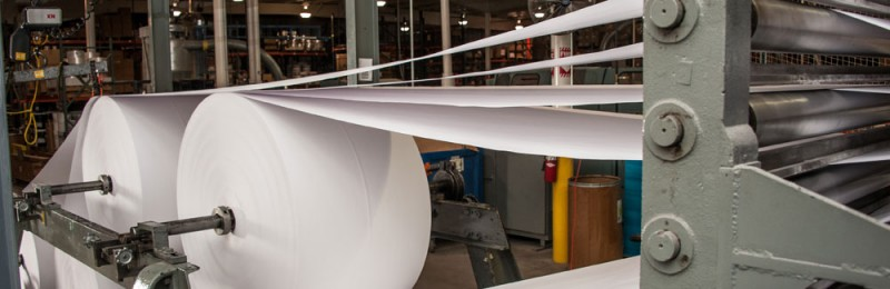 Material Options - Large format sheeter cuts roll stock down to sheet sizes for our high-quality offset presses